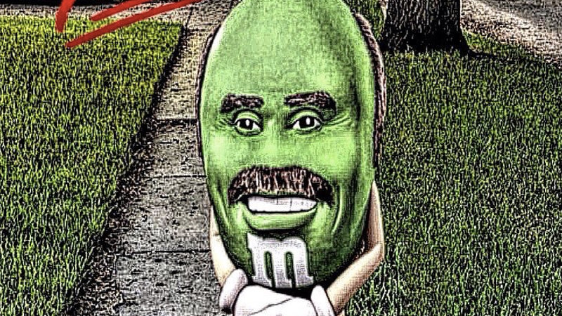 "Green M&M with Dr. Phil's face posing like the ""You know I had to do it to 'em"" guy"