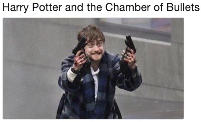 Daniel Radcliffe Holding Two Guns