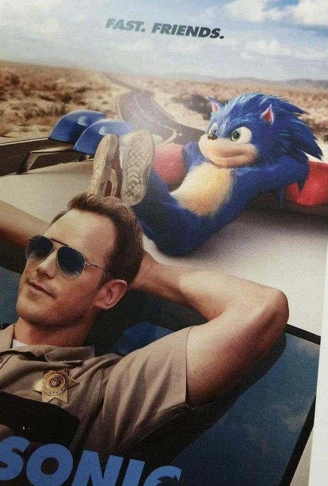 poster for live action Sonic the Hedgehog movie with him and Chris Pratt lounging in a car with the caption fast friends