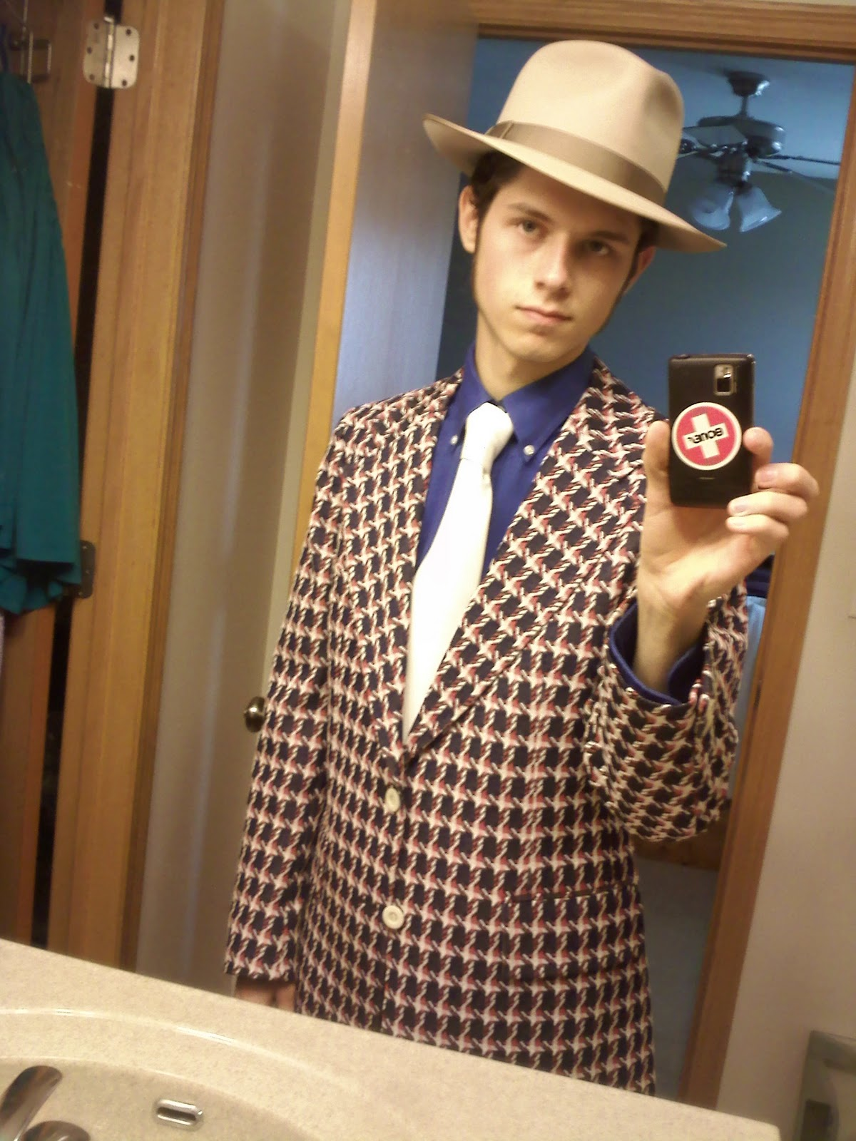 Okay the hats bad but that suit.... my eyes regret seeing this ... 0bf9d42370b