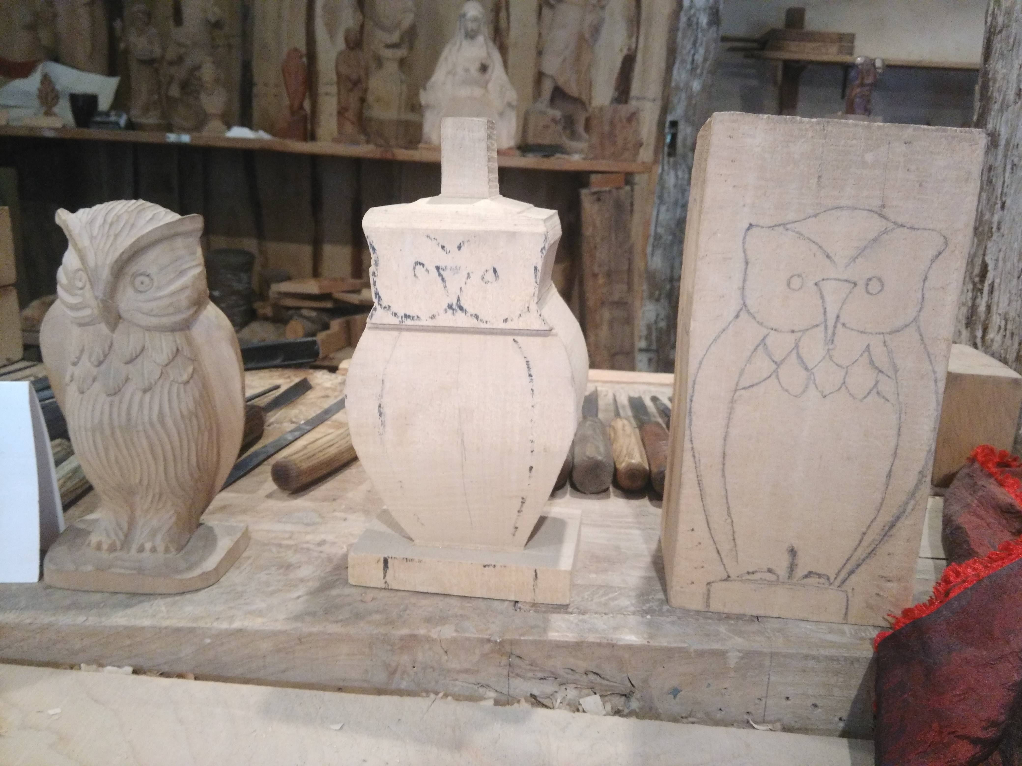 Relief owl carving in spruce chainsaw flapdisk and flame