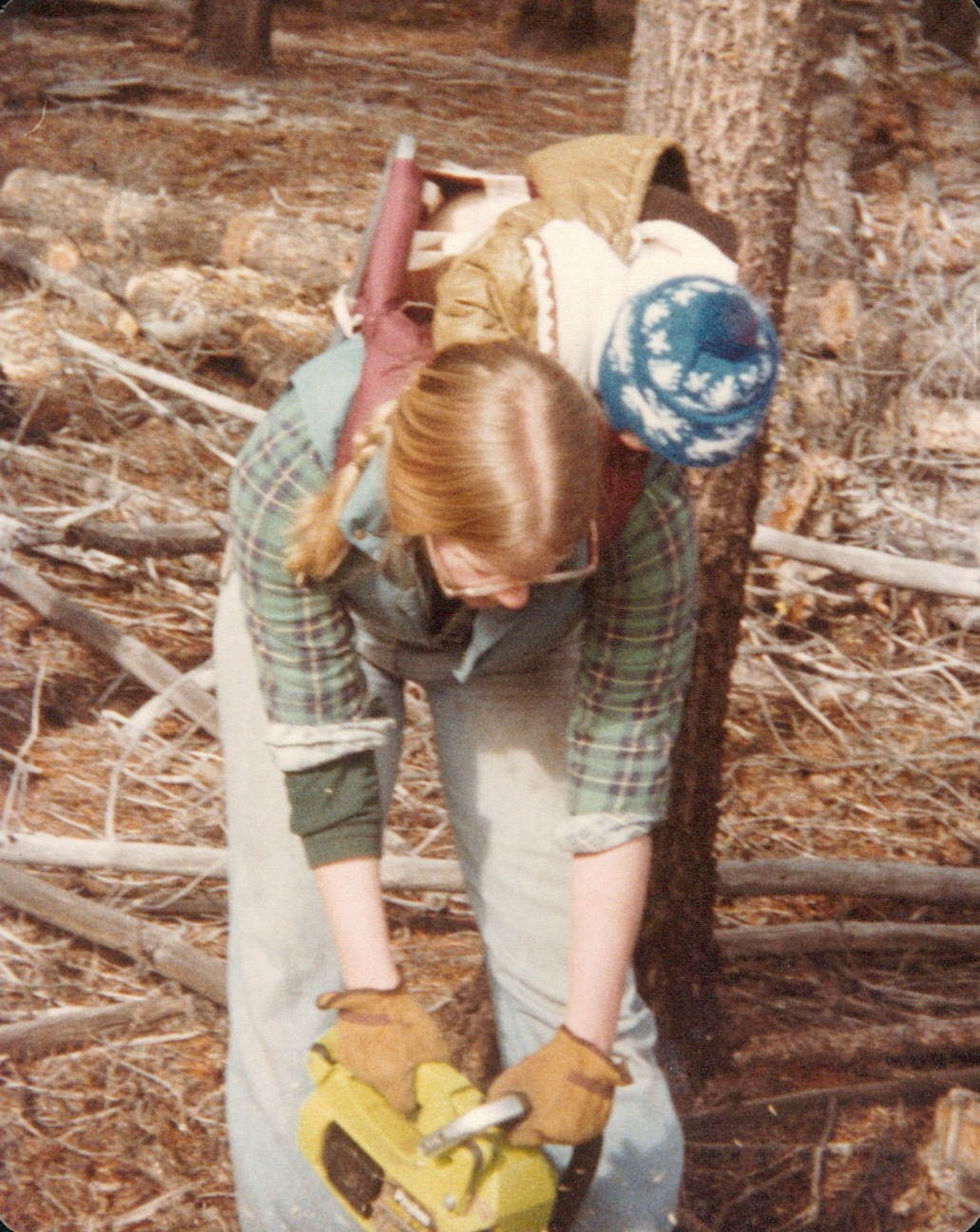My Mom in the early 80's doing some chainsawing with me on