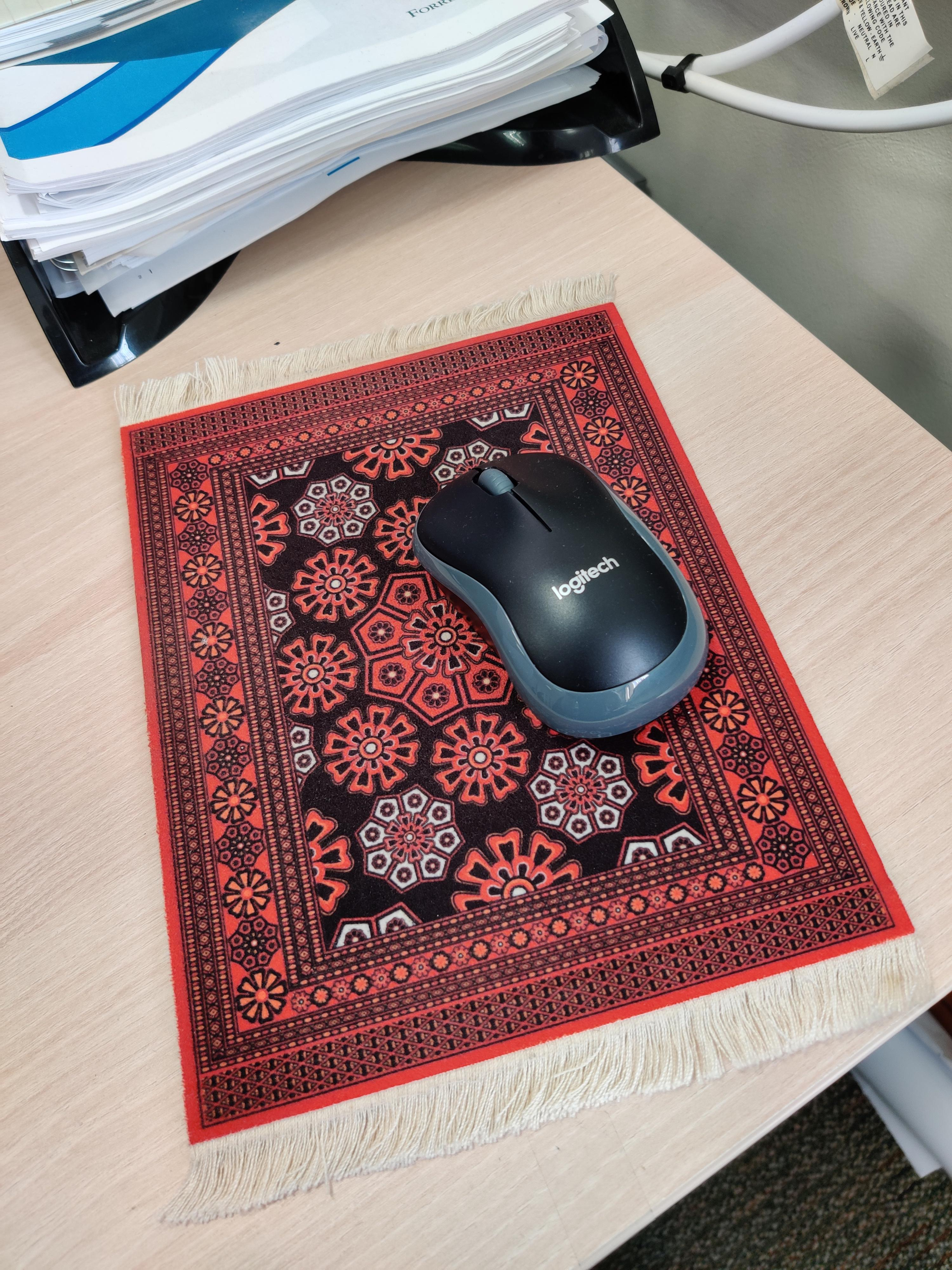 This magic carpet mouse mat my boss uses in work   r