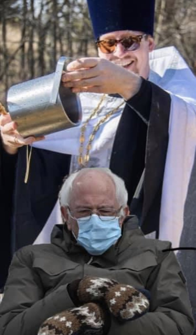 Welcome To The Orthodoxy Son Bernie Sanders Wearing Mittens Sitting In A Chair Know Your Meme